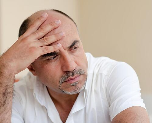 man-struggles-with-midlife-crisis